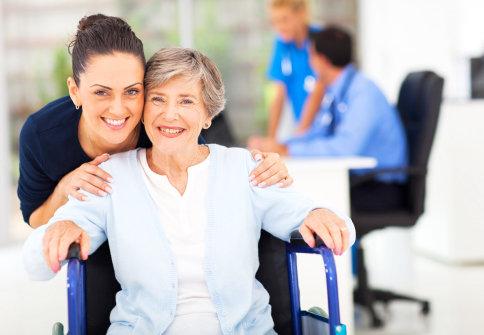 caregiver and a senior woman having daily check up
